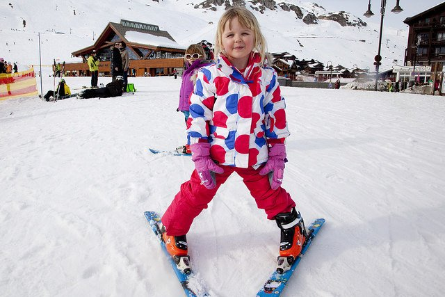 Kids skiiing on holiday