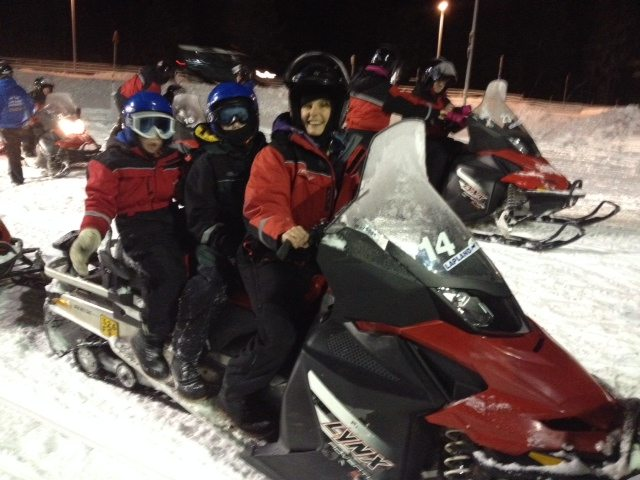 Exploring on snowmobiles on a family adventure to Lapland