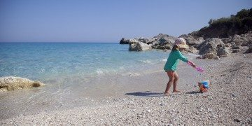 Girl on the beach in Greece