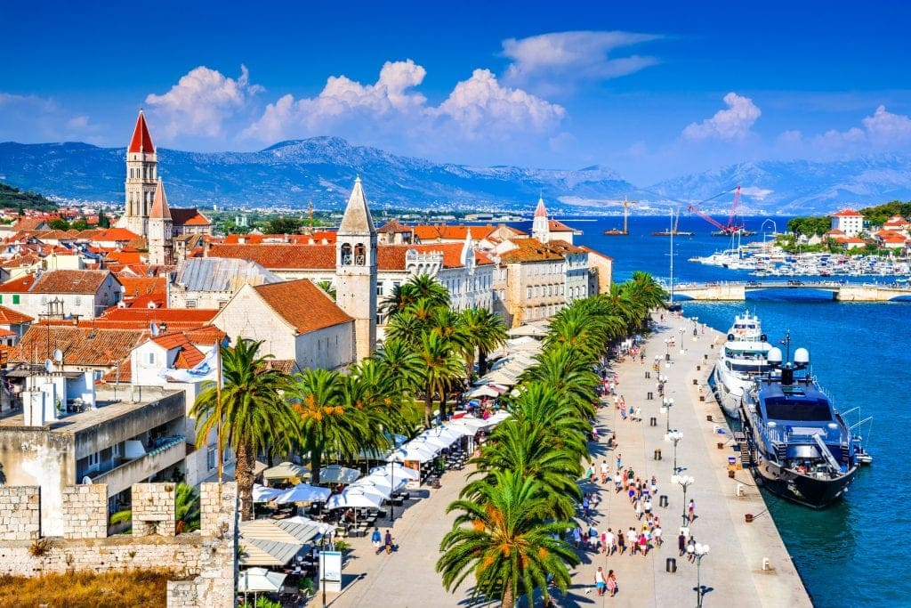 Trogir, Croatia. Sunny promenade along the pier of old Venetian town, Dalmatian Coast in Croatia.