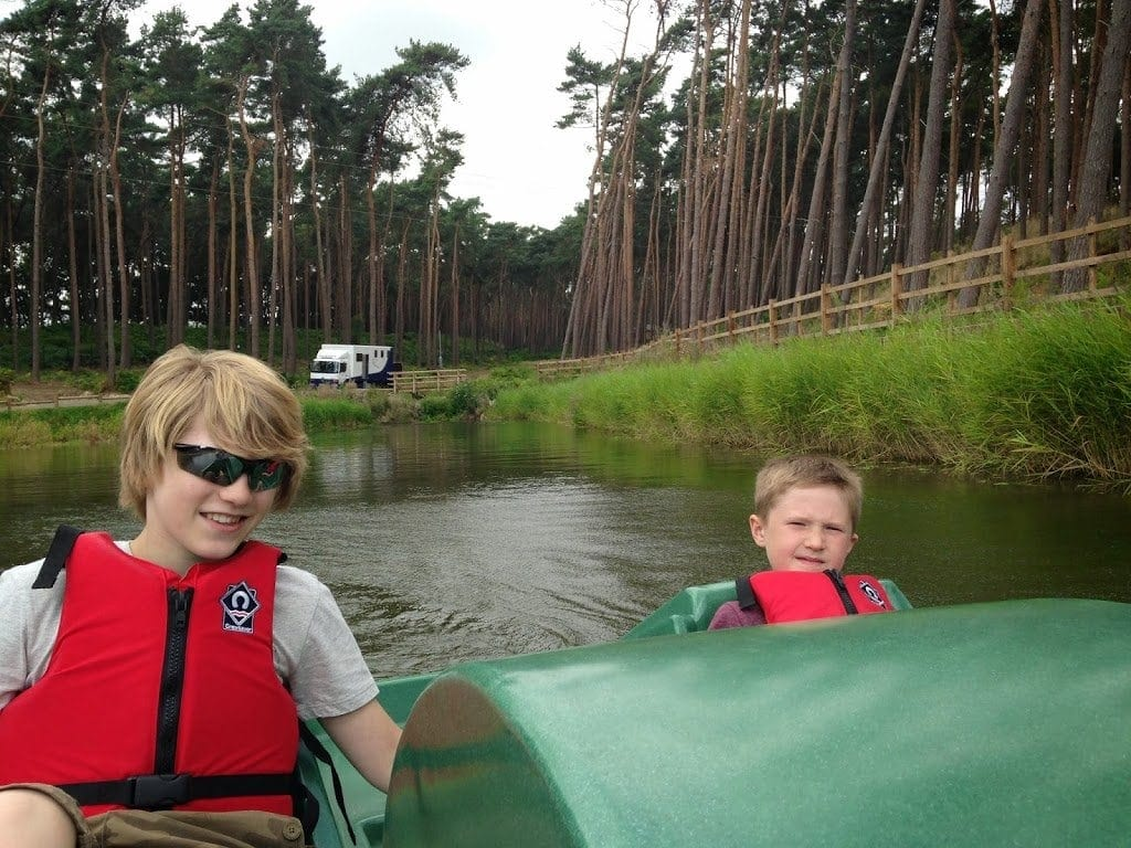 two boys on a pedalo, august in center parcs