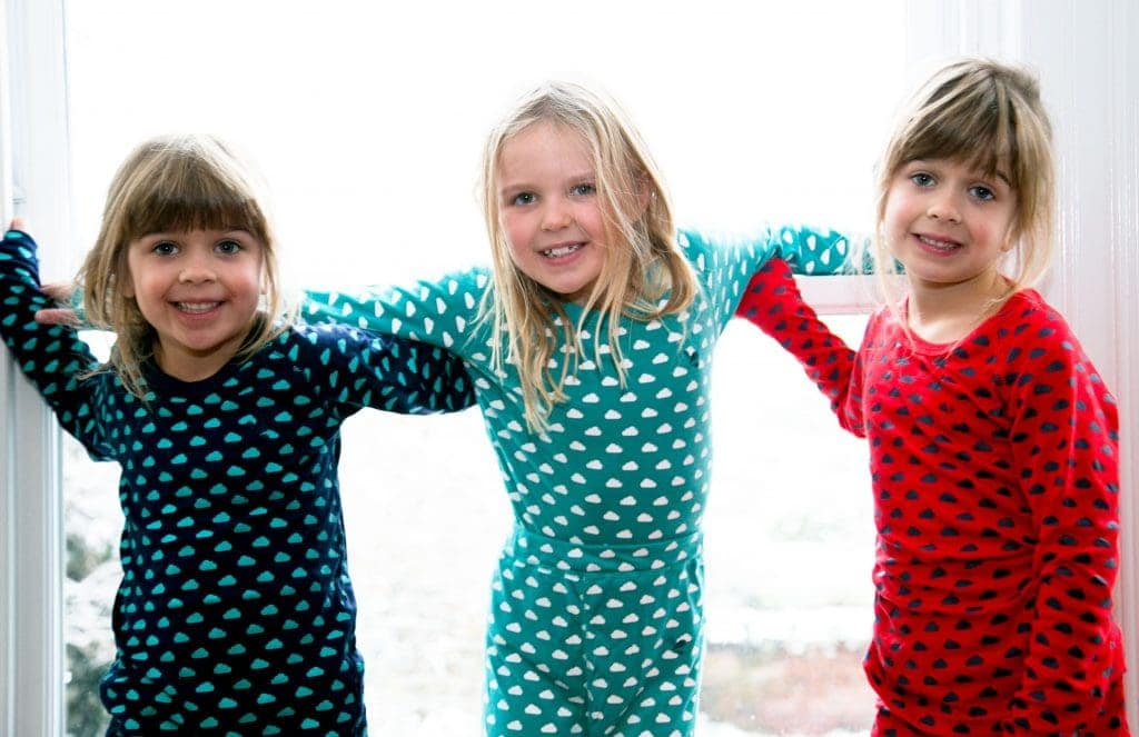 Children in pyjamas, excited about heading to Santa's Lapland for Christmas Day