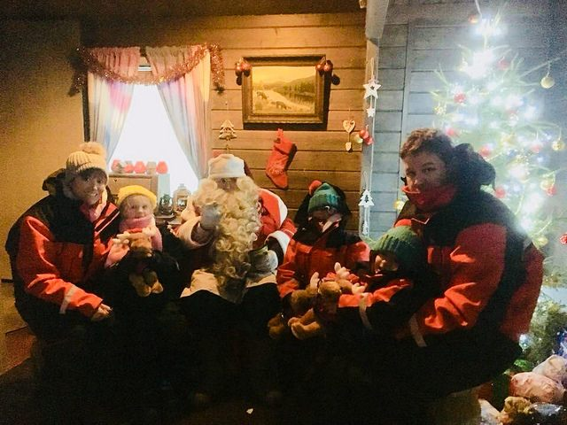 Meeting Santa in the cabin, as part of Search for Santa Day at Santa's Lapland