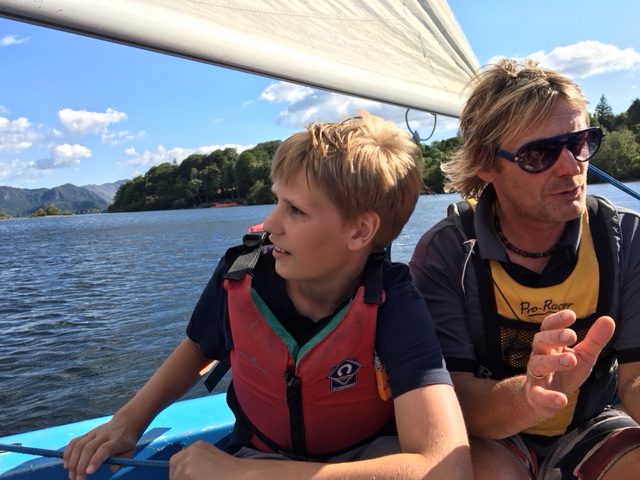 Learning to sail with kids on a boat in the Lake District