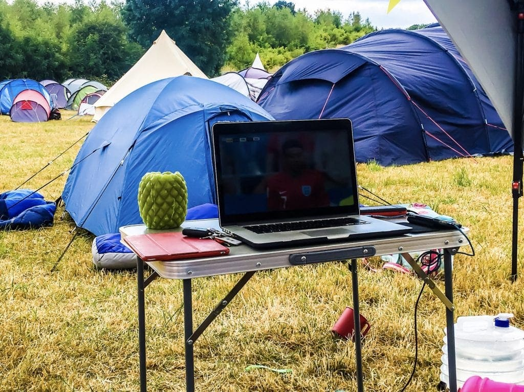 Relaxing under the Coleman Event Shelter FastPitch™ Shelter XL at a family friendly festival